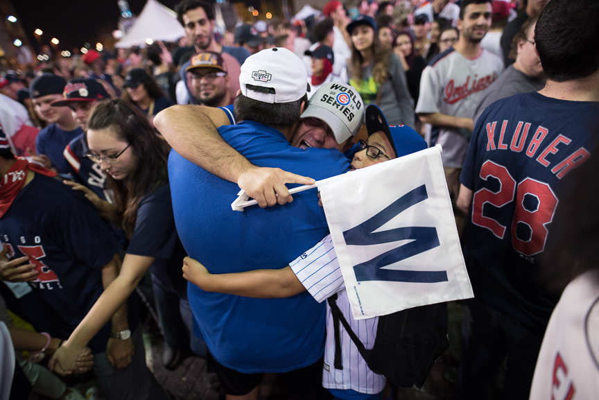 Chicago Cubs fans hug outside of Progressive Field after game 7 of the World Series between the Cleveland Indians and the Chicago Cubs on November 3, 2016 in Cleveland, Ohio. The Chicago Cubs defeated the Cleveland Indians 8-7.