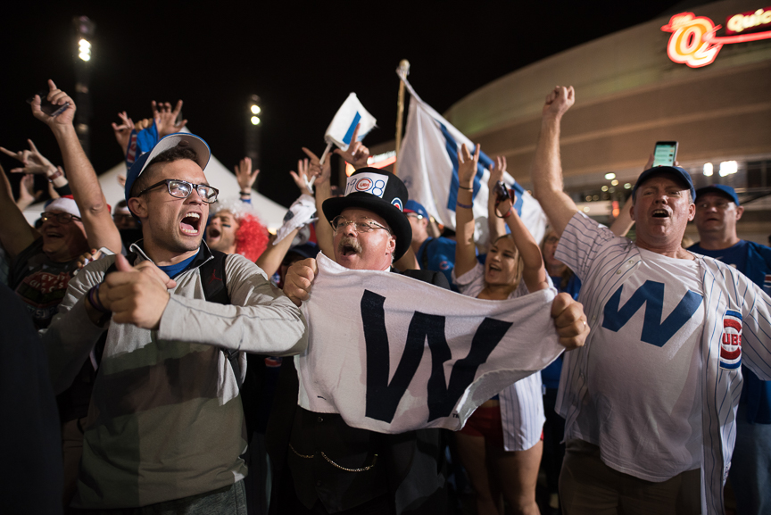 Cubs fans celebrate after the Chicago Cubs defeated the Cleveland Indians 8-7 in game 7 of the World Series on November 3, 2016 in Cleveland, Ohio.