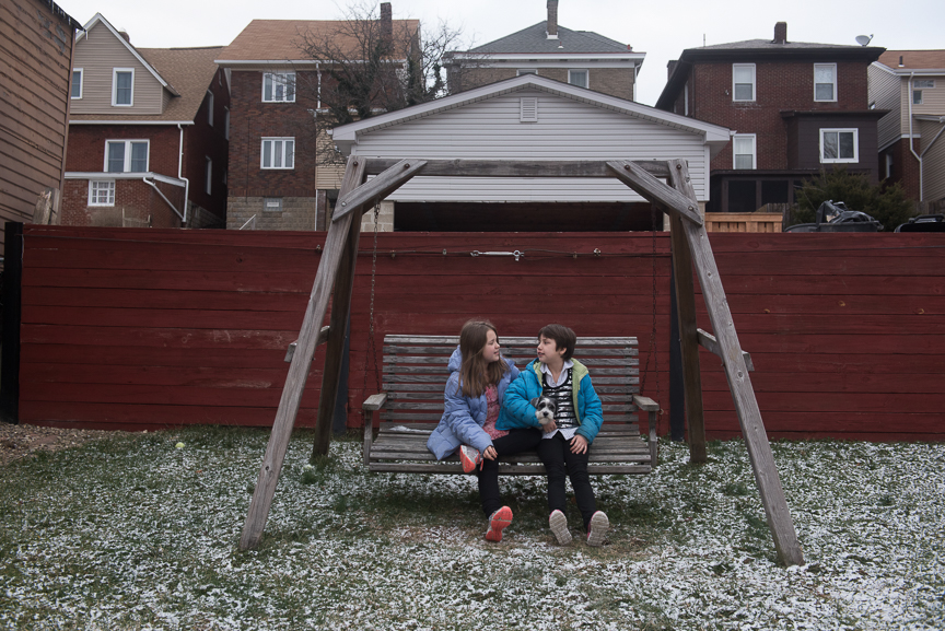 Sabrina, right, sits on her swing with her sister, Gabby, 10,