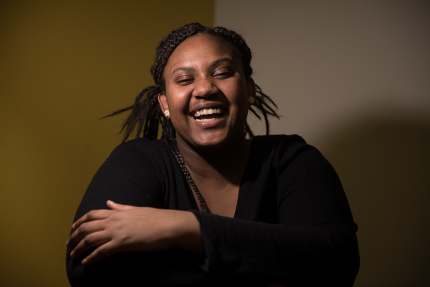 Monet Spencer, 18, smiles as she is photographed in her Hill District apartment. Spencer was left homeless after her mother passed away in February 2016, leaving her and her twin brother to care for themselves. Spencer now lives on her own, in a subsidized apartment. Spencer attends Brashear High School and was recently accepted to Carlow University.
