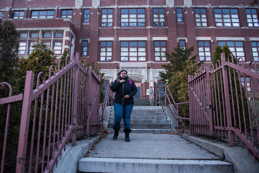 Monet Spencer, 18, walks from Pittsburgh Miller PreK-5 after tutoring young elementary students on February 13, 2017. Thirty percent of Spencer's salary from her tutoring job helps pay for her apartment at Action Housing's My Place, which provides housing and intensive case management services to young people who have aged out of the foster care system in Allegheny County and are either homeless or at risk homelessness.