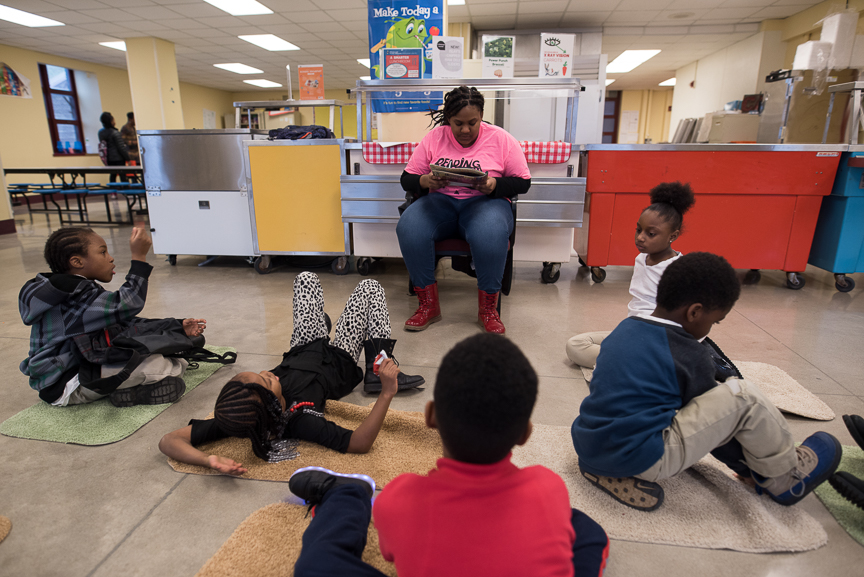 Monet Spencer reads to elementary students at Pittsburgh Miller PreK-5 on Feb. 8, 2017. She tutors at the school Mondays though Thursdays for a job through the Neighborhood Learning Alliance.