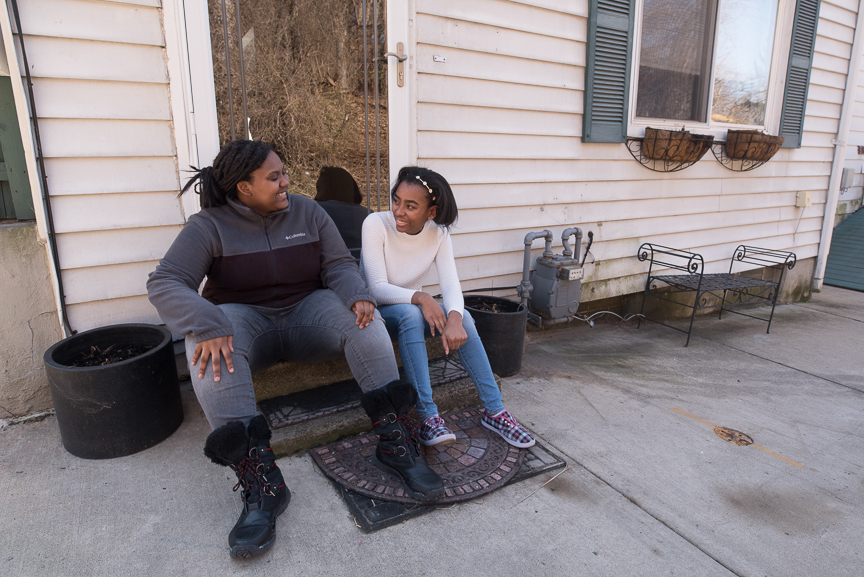 Monet Spencer, 18, left, sits with her best friend, Maya Smallwood, 18, at her North Side home where Maya and her mother took Spencer in to live after her mother died and she was left homeless.