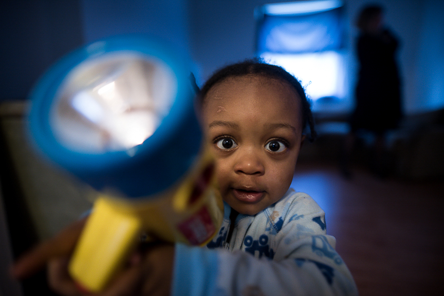 Dorian, 2, plays with a flashlight at his Braddock home on Feb. 28, 2017.