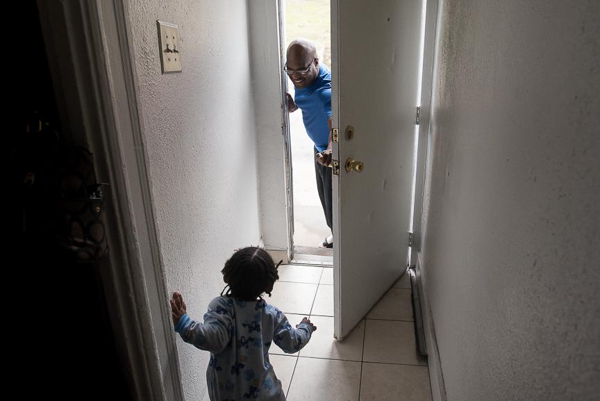 Dorian Baker, 2, stands in the doorway of his Braddock home on Feb. 28, 2017.