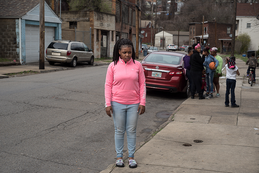 As the family gathered for her son's second birthday, Dezmaire Baker watched after him and stood near the edge of the sidewalk to stop Dorian from running into the street.