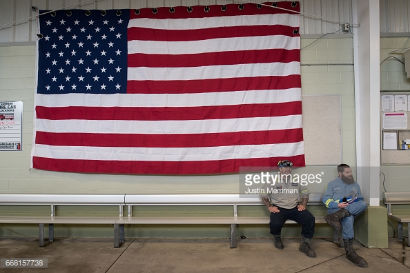 SYCAMORE, PA - APRIL 13: Coal miners wait for the start of an event with U.S. Environmental Protection Agency Administrator Scott Pruitt who visited the mine and spoke with miners at the Harvey Mine on April 13, 2017 in Sycamore, Pennsylvania. The Harvey Mine, owned by CNX Coal Resources, is part of the largest underground mining complex in the United States. (Photo by  Justin Merriman /Getty Images)