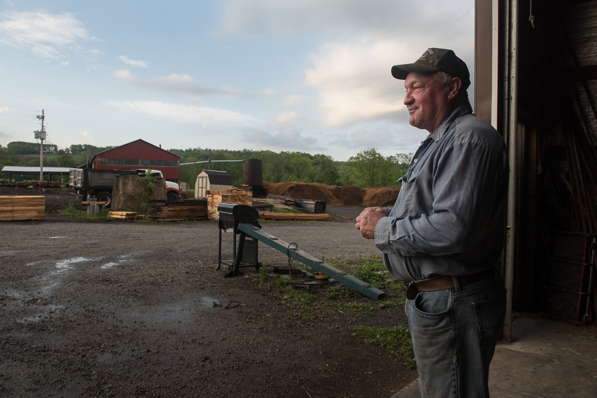 """George Critchfield, 59, owner of Critchfield Lumber, stands at his mill on May 19, 2017 in Jenner Township, Pa. The new Corsa Coal Corporation mine has purchased lumber from Critchfield's lumber mill, which borders the new mine site. He is excited about the mine's opening and feels the mine has saved his business. """"It's a trickle down effect,"""" he says. """"That's what you need, good paying jobs instead of McDonalds and Walmart.""""  Justin Merriman  for The Wall Street Journal"""