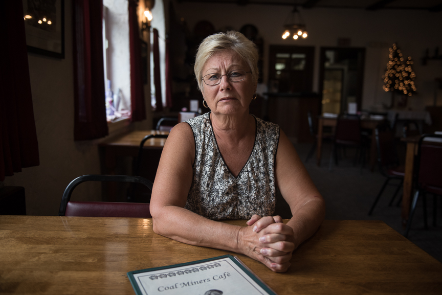 """Betty Rhoads, who owns the Coal Miner's Cafe with her husband, John, sits at one of the restaurant's tables on May 18, 2017 in Jennerstown, Pa. """"I've seen the good day's of coal,"""" says Rhoads;her father owned several pick and shovel coal mines. """"I can remember when there was mines all over these hills,"""" she says. While she's not optimistic about the coal mining industry, Rhoads is happy about the opening of the Acosta Deep Mine. """"I want every mine that can reopen to reopen,"""" she says. Justin Merriman  for The Wall Street Journal"""