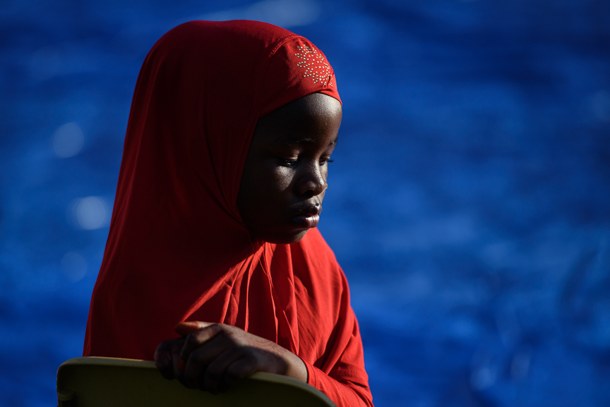 Eheze Hassani, 8, of Sharpsburg, Pa., sits in a chair as she waits for the prayer to begin during an Eid al-Fitr celebration, which marks the end of Ramadan, on June 25, 2017 in Pittsburgh, Pennsylvania. (Photo by Justin Merriman/Getty Images)