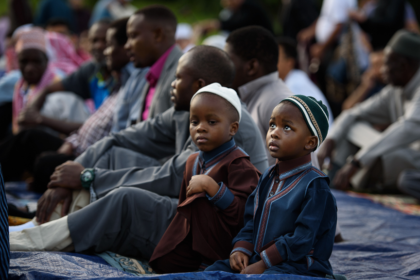Young boys wait for the beginning of a prayer during an Eid al-Fitr celebration, which marks the end of Ramadan, on June 25, 2017 in Pittsburgh, Pennsylvania. (Photo by Justin Merriman/Getty Images)