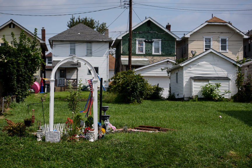 A memorial sits at the site where an April 2015 fire took the lives of Mae Etta Richmond, 70, and Te'on Dillard, 2, along Wellesley Avenue in Steubenville, Ohio on Tuesday, Aug. 22, 2017. The fire was part of a wrongful death suit that Nathaniel Richmond filed on behalf of his mother, Mae Etta and had pending before Judge Joseph Bruzzese Jr. Richmond was shot and killed on Monday after he ambushed the Judge Bruzzese outside of the Jefferson County courthouse.  Justin Merriman for DailyMail.com