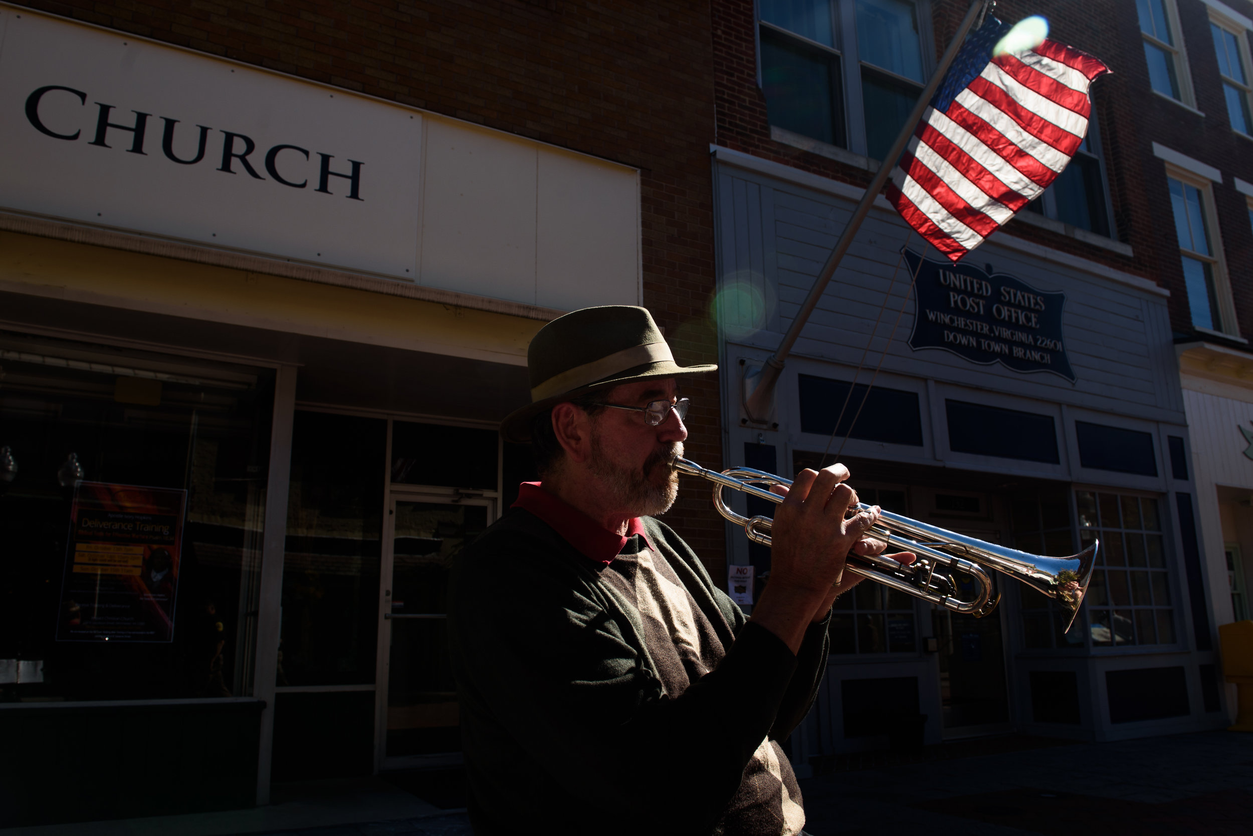Daren Johnson, 64, busks on Tuesday, Oct. 17, 2017 along the promenade of the Loudoun Street Pedestrian Mall in Winchester, Va. Johnson, a retired school teacher and former supporter of Hillary Clinton, is exhausted by recent elections, but will vote in the upcoming gubernatorial election. Being uninsured and relying on a free healthcare clinic he cares deeply about the state of healthcare in America. Read more about this story in  The New York Post .