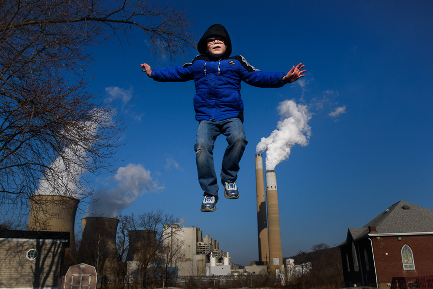 I spent several days traveling around Pennsylvania, Ohio and West Virginia for Bloomberg and ran across Aaron Schissler, 8, as he jumps on his trampoline at his home near FirstEnergy's Bruce Mansfield Power Plant on Sunday, December 3, 2017 in Shippingport, Pa. You can see more of my images from this shoot at  Bloomberg .