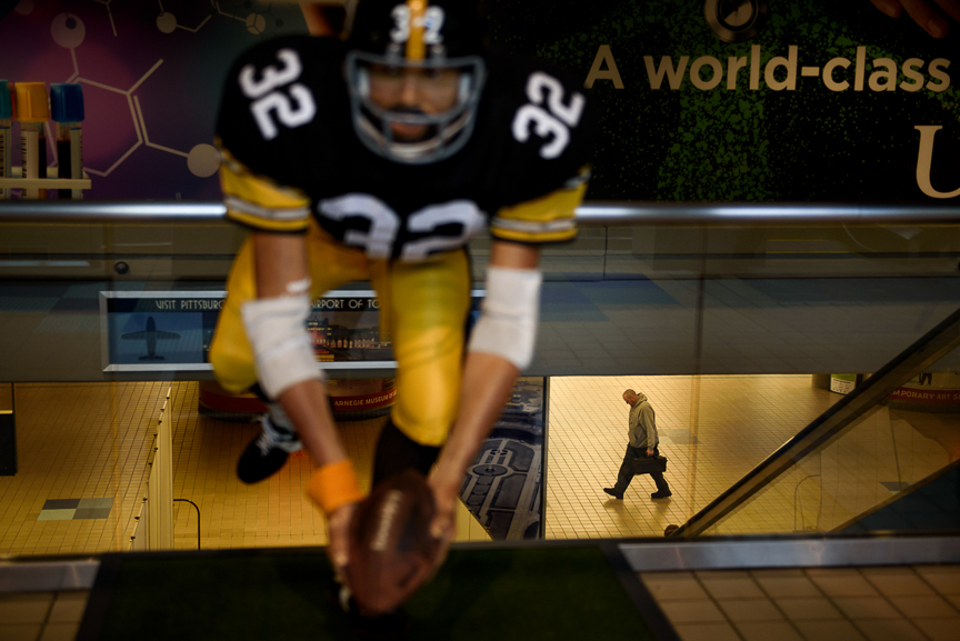 A traveler walks near a statue of Pittsburgh Steeler legend Franco Harris as he gets off of a train that moves passengers from the landslide terminal to the airside terminal at Pittsburgh International Airport on December 14, 2017 in Moon, Pa. 