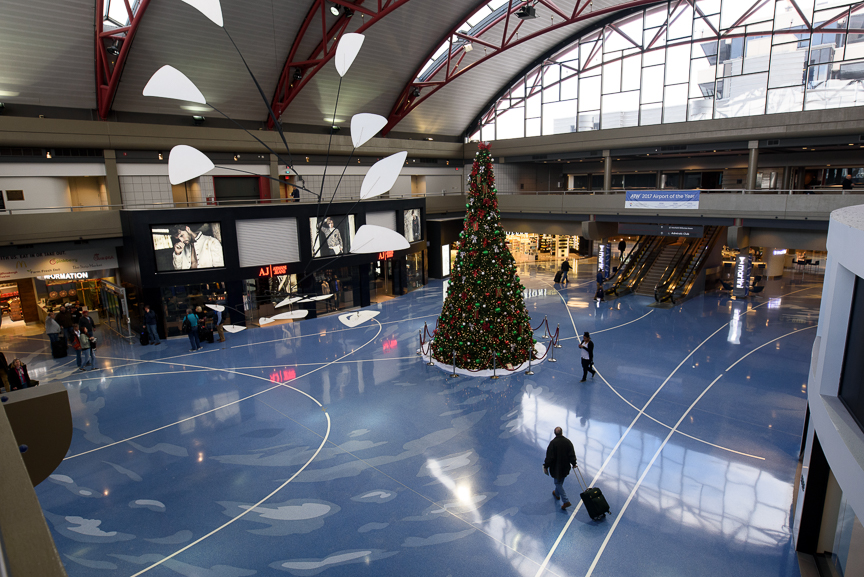 Travelers walk through an area that is planned to be the main entrance of the Pittsburgh International Airport on December 14, 2017 in Moon, Pa. 