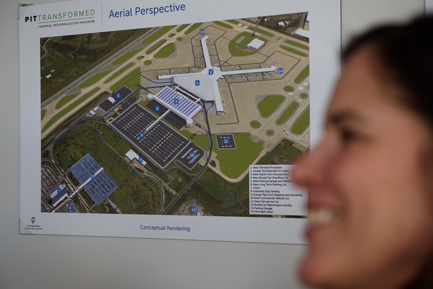 Christina Cassotis, Allegheny County Airport Authority chief executive, stands near a conceptual rendering of the future plans for the Pittsburgh International Airport on Thursday, December 14, 2017 in Moon, Pa. 