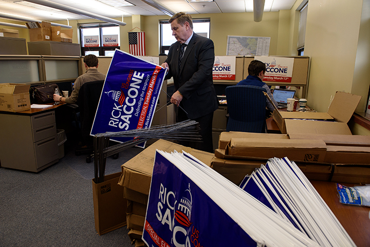 Rick Saccone, a Republican state lawmaker running for a US House seat in Pennsylvania's 18th Congressional District puts together campaign signs in his office on February 8, 2018 in Canonsburg, Pa.