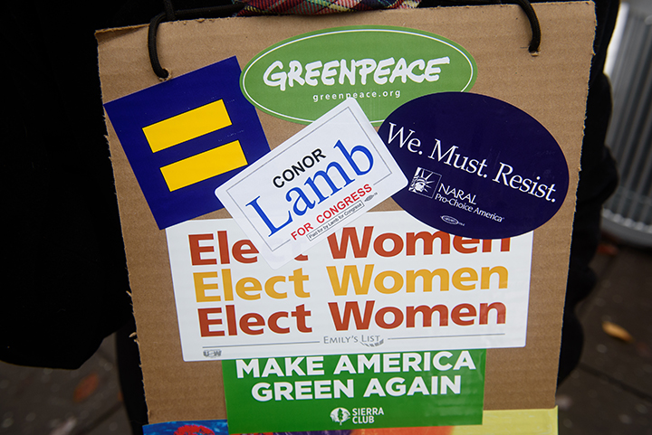 """A Conor Lamb supporter has a 'Conor Lamb for Congress' sticker on her sign as she joins in The Women's March on Washington - Pittsburgh """"Power to the Polls"""" in Market Square on Sunday afternoon, January 21, 2017 in downtown Pittsburgh. Thousands came to Pittsburgh to join women's marches across the country this weekend."""