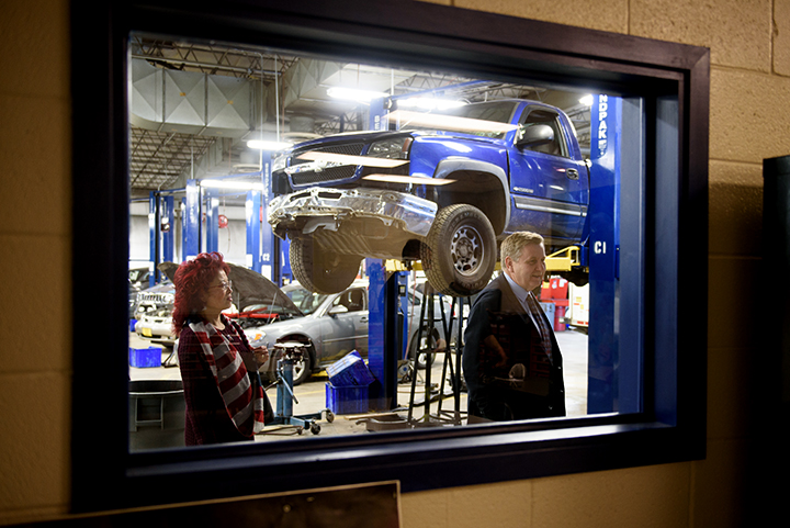 Rick Saccone, a Republican state lawmaker running for a US House seat in Pennsylvania's 18th Congressional District, and his wife, Yong, are seen through a window of Rosedale Technical College, as they tour the facility on Monday, February 12, 2018 in Kennedy Township, Pa.