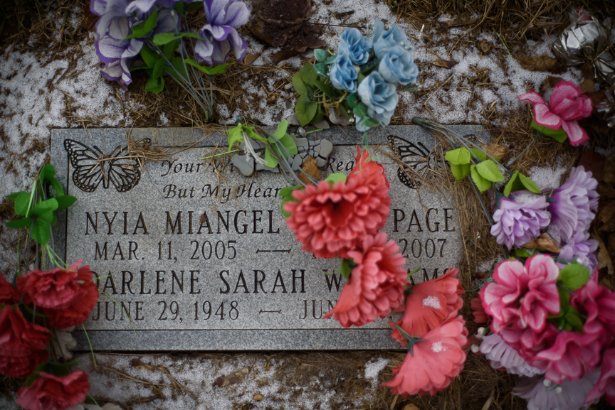 Nyia Page's headstone sits in a dusting of snow and surrounded by fake flowers in Fairview Cemetery on Feb. 25, 2018, in McKeesport, Pa.
