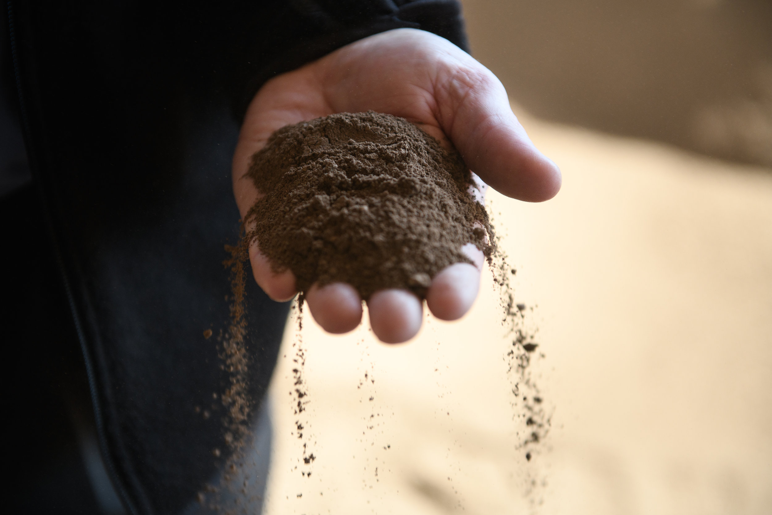 Grant McKnight, president and founder of DuraEdge, holds some of the raw mineral from his raw clay production in his hand on Monday, March 19, 2018 in Slippery Rock, Pa. DuraEdge is the country's top producer of baseball dirt. Their mix of clay, sand and silt will be used at many ballparks in Major League Baseball.  - Justin Merriman for The Wall Street Journal