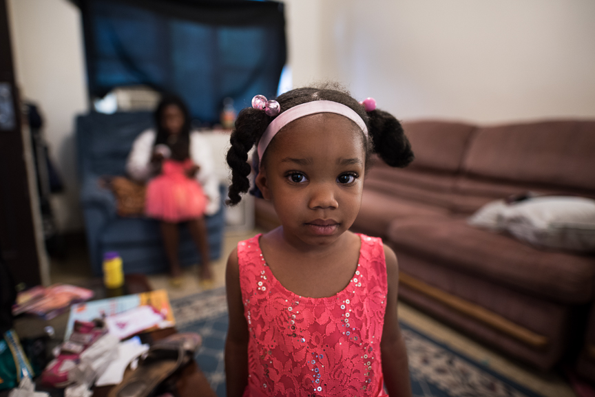 Trinity Glenn, 3, stands in her grandmother's living room on June 9, 2017 in Fineview, a neighborhood in Pittsburgh, Pa.
