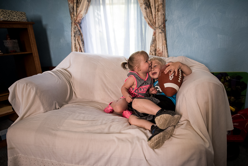 Cameron Gorman, 3, sits with his one-year-old sister, Layla, at their great-grandmother's house on June 10, 2017 in Esplen, a neighborhood in Pittsburgh, Pa. The two began living with with their great-grandmother, Patricia Savulchak, 73, who has kinship caregiver status, after their mother died of an opioid overdose in March.