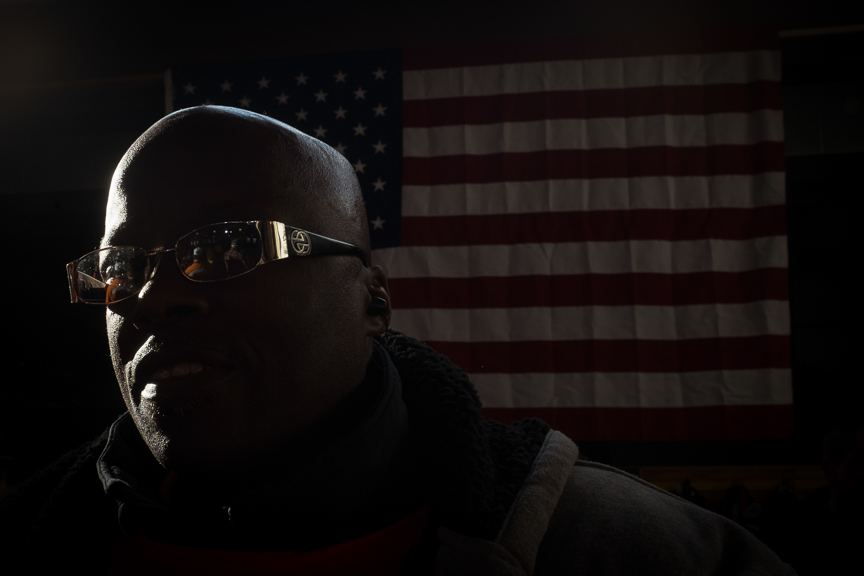 Douglas Ray, 55, of Homewood, Pa., stands near a flag in the back of a rally for  Conor Lamb, Democratic candidate for Pennsylvania's 18th Congressional District, at the Carpenters Training Center on Tuesday, March 6, 2018 in Collier Township, Pa.