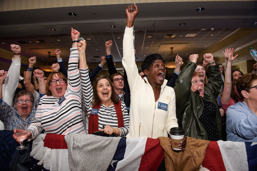 Supporters of Conor Lamb react as results show him pulling ahead in Pennsylvania's 18th congressional district special election at Conor Lamb's campaign headquarters at Hilton Garden hotel on Tuesday, March 13, 2018 in Southpointe, Pa.