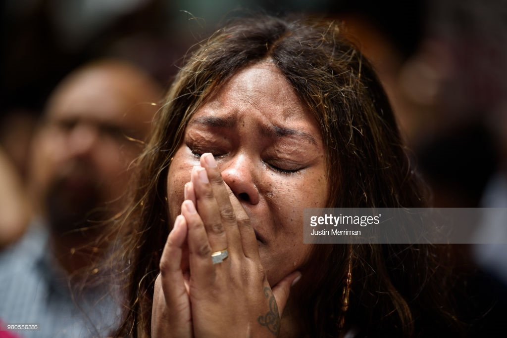 Malika Collins-Berry of Wilkinsburg, Pa., cries as she joins a rally in front of the Allegheny County Courthouse on June 21, 2018 in Pittsburgh, Pennsylvania. Over 200 people gathered in the aftermath of a fatal shooting of Antwon Rose, an unarmed black teen, by an East Pittsburgh police officer Tuesday night. The organizers called on Allegheny County District Attorney Stephen Zappala Jr. to bring criminal charges against the officer who fatally shot Rose during a traffic stop. (Photo by Justin Merriman/Getty Images)