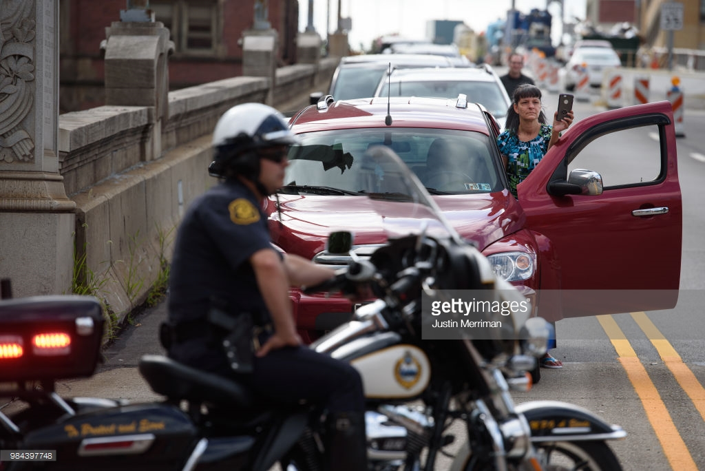 A motorist films a protest a day after the funeral for Antwon Rose II that blocked streets on June 26, 2018 in Downtown, Pittsburgh, Pennsylvania. Rose was killed by an East Pittsburgh police officer on Tuesday, June 19 when he fled on foot from a traffic stop and was shot three times in the back. Days of protest and unrest have continued in the wake of his death. (Photo by Justin Merriman/Getty Images)