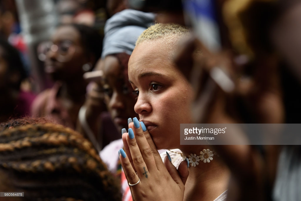 Cherise Green, 24, of Pittsburgh's Hill District, joins over 200 people gathered for a rally to protest the fatal shooting of an unarmed black teen at the Allegheny County Courthouse on June 21, 2018 in Pittsburgh, Pennsylvania. Antwon Rose, 17, was killed by an East Pittsburgh police officer Tuesday night when the he ran after police stopped a vehicle he was in that was suspected to be involved in an earlier shooting. The organizers of the rally called on Allegheny County District Attorney Stephen Zappala Jr. to bring criminal charges against the officer who fatally shot Rose. (Photo by Justin Merriman/Getty Images)