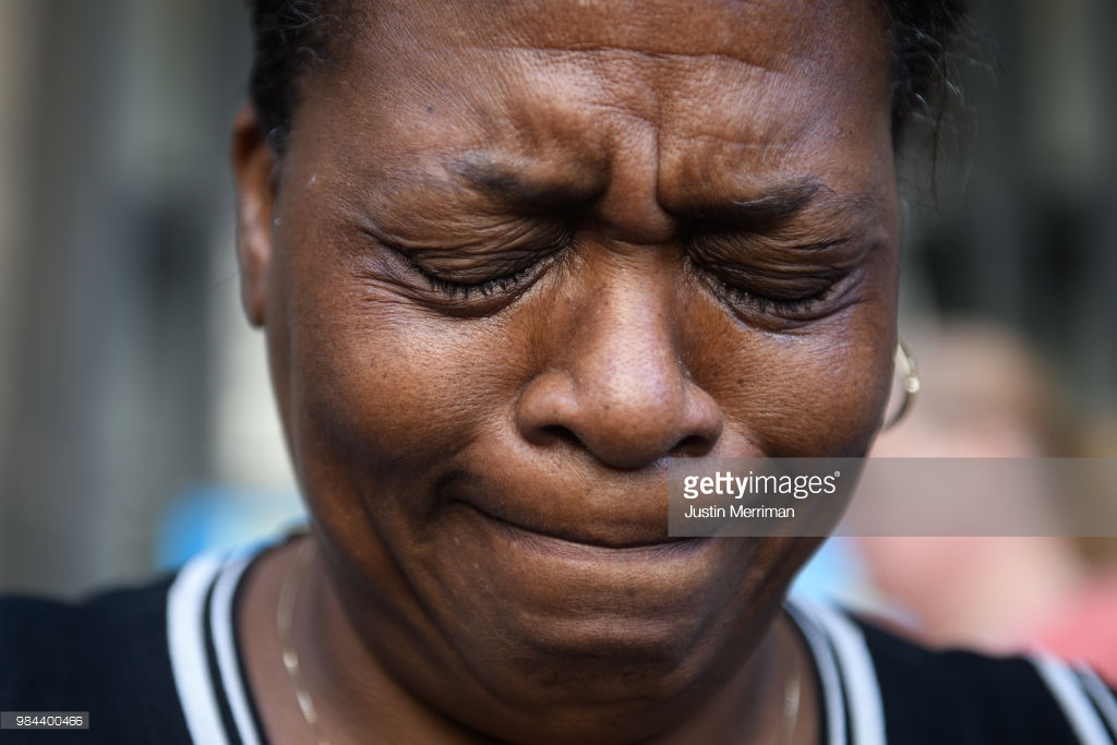 Carmen Ashley, the great aunt of Antwon Rose II, cries during a protest calling for justice for the 17-year-old on June 26, 2018 in Downtown, Pittsburgh, Pennsylvania. Rose was killed by an East Pittsburgh police officer on Tuesday, June 19 when he fled on foot from a traffic stop and was shot three times in the back. Days of protest and unrest have continued in the wake of his death. (Photo by Justin Merriman/Getty Images)