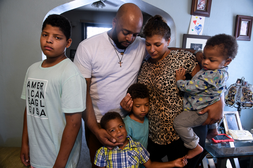 Michael and Ashley Cannon stand with their children, left to right, Pierce 12, Niles, 4, Clark, 5, and 17-month-old Beaux in their home on June 24, 2018 in East Pittsburgh, Pa. They live very close to the location where Antwon Rose II was killed by an East Pittsburgh police officer on Tuesday, June 19, and now struggle with what Rose's death means to them and their community. (Photo by Justin Merriman/For The Washington Post)