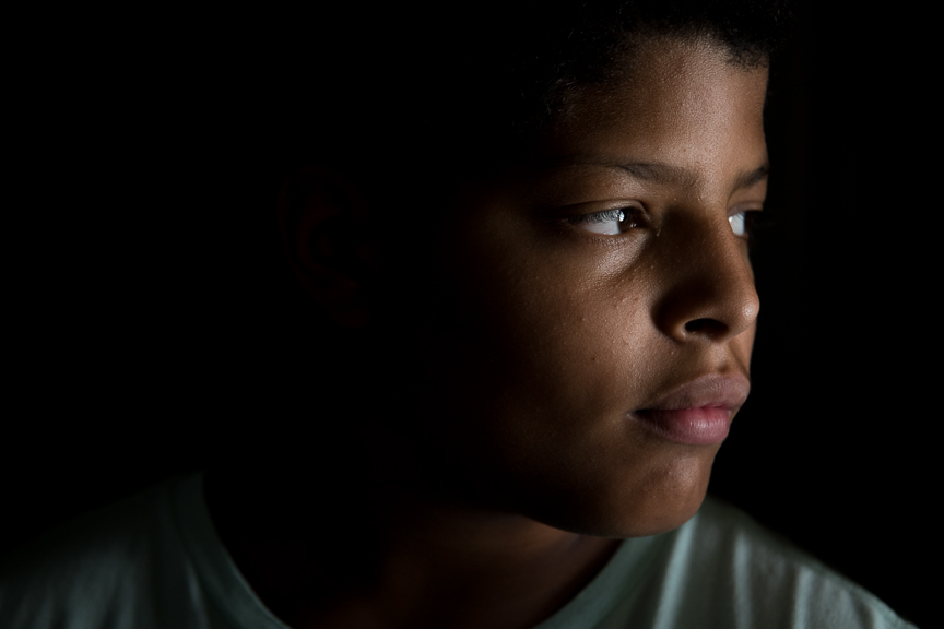 """Pierce Cannon, 12,  stands in his home on June 24, 2018 in East Pittsburgh, Pa. """"My fear is out of nowhere I'm just gonna get shot,"""" he says."""