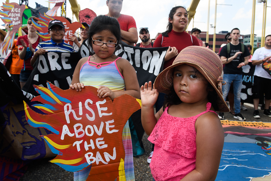 Yarizeo Morales, 4, right, and her sister, Yulissa, 7, join in the �We Will Not Be Banned!� protest as it marched through Downtown Pittsburgh, Pa. on Sunday, July 1, 2018. The rally was in response to the Supreme Court decision announced this week to uphold the Muslim Ban, as well as protesting the separation of children on the border with Mexico and the recent police shooting of Antwon Rose II in East Pittsburgh, Pa.
