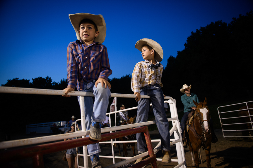 Cash Austin Lee Markel, 9, right, and his brother, Carter James Callahan, 6, of Dover, Pa., sit on fencing as they watch the Fort Armstrong Championship Rodeo on Friday, July 13, 2018 at the Crooked Creek Horse Park in Ford City, Pa.