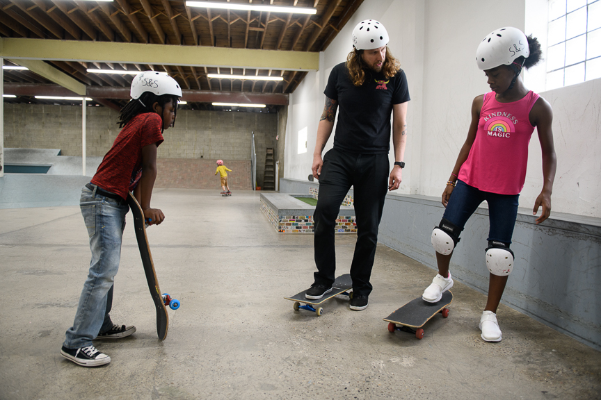 Kerry Weber, 37, owner of Switch and Signal Skatepark, helps teach kids to skate on Sept. 1, 2018 in Swissvale, Pa.