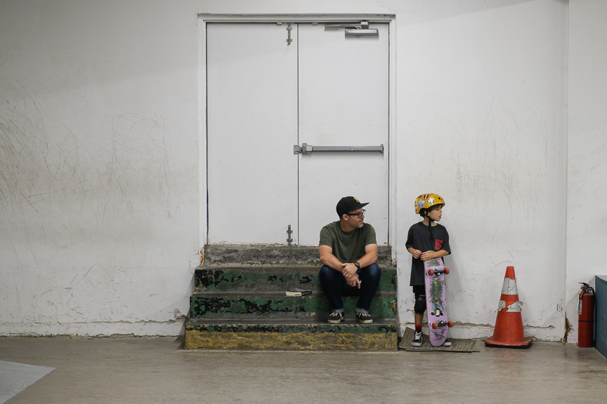 Matthew Newton of Wilkins Township, sits with his son, Nico, 7, as he skates at Switch and Signal Skatepark on Sept. 1, 2018 in Swissvale, Pa.