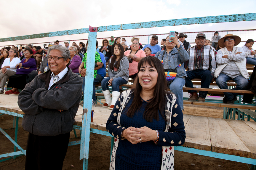 Clayton Long, left, and Charlotta Lacy, right, watch the crowning of Miss Northern Navajo is crowned at the Shiprock Northern Navajo Nation Fair on October 5, 2018 in Shiprock, New Mexico. The fair is the the oldest and most traditional of the Navajo fairs. It's held each fall to celebrate the year's harvest with a community celebration. The Navajo traditional healing ceremony Yeibicheii is held throughout the fair.