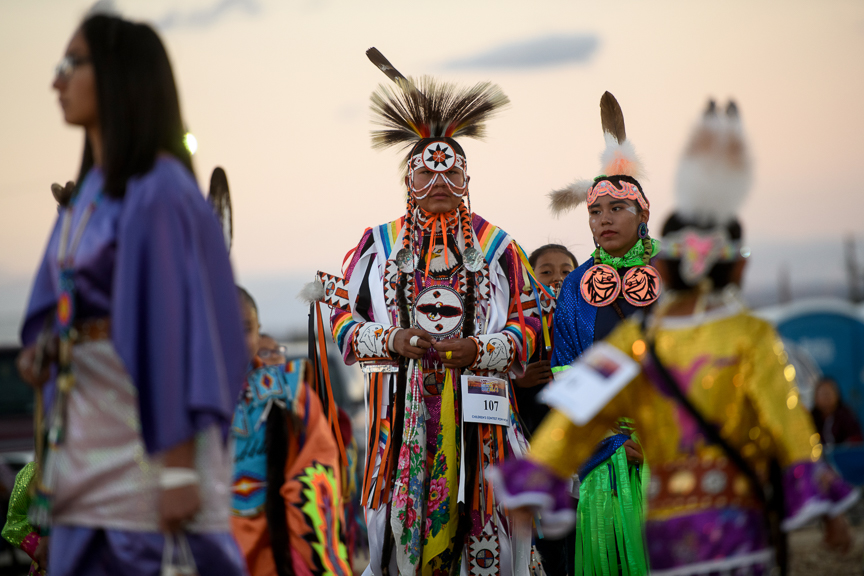 People participate in a Pow Wow at the Shiprock Northern Navajo Nation Fair on October 5, 2018 in Shiprock, New Mexico.
