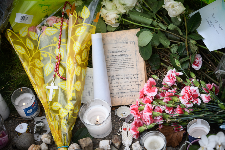Mourners leave flowers and other items at a makeshift memorial near the Tree of Life Synagogue.