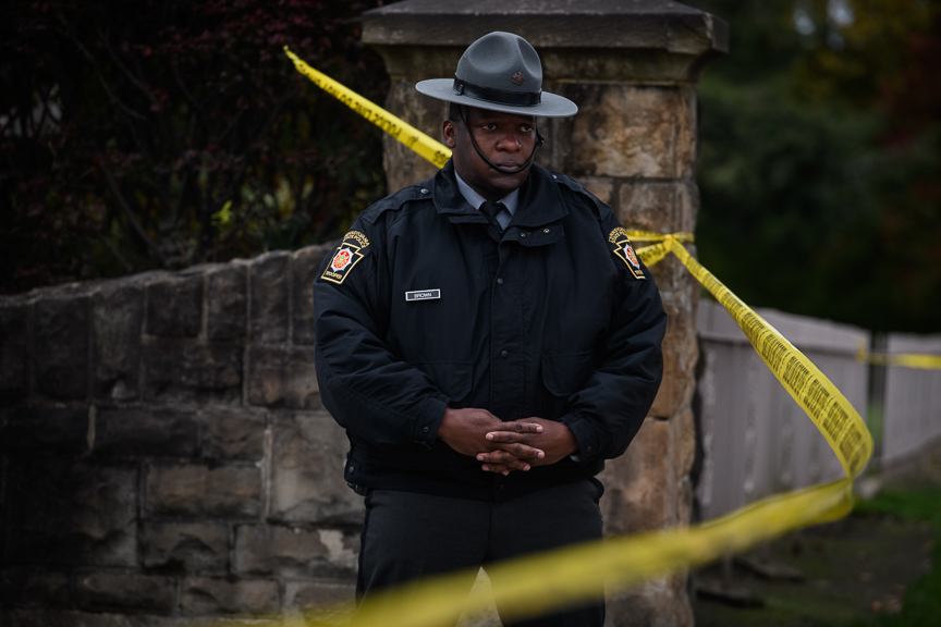 A Pennsylvania State Police Trooper stands watch near the Tree of Life Synagogue on Monday, October 29, 2018.