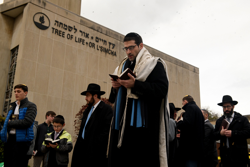Members of the Jewish faith gather in front of the Tree of Life Synagogue for the Shabbat on Friday evening, November 2, 2018 in Pittsburgh's Squirrel Hill neighborhood.