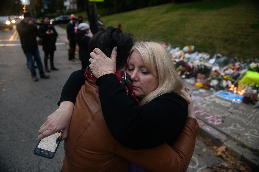 Sheila May-Stein of Wilkins Township hugs a fellow mourner after a supporter of President Trump upset her as she visited a makeshift memorial near the Tree of Life Synagogue.