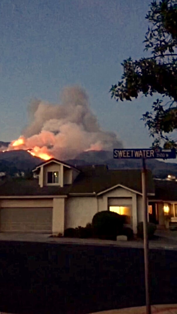 A hill behind a house in Corona burns throughout the night until the morning.    Photo by: Hannah Enriquez
