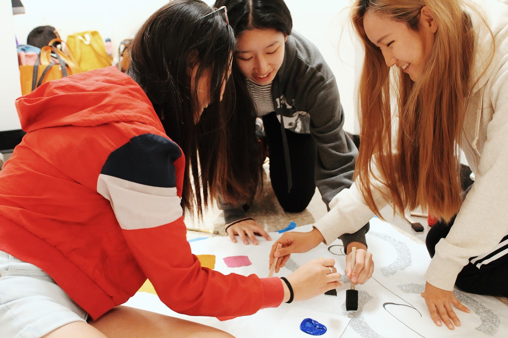 Members of the Leadership class working hard on posters. From right to left: Lauren Lee (CAHC '21), Angeline Xu (CV '22), and Lauren Sung (IDBR '22).
