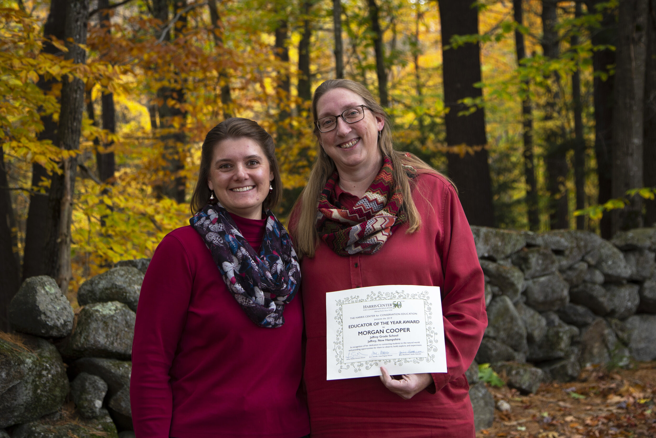 """Harris Center naturalist Jaime Hutchinson (left) presented Morgan Cooper (right) with the Harris Center's """"Educator of the Year"""" Award for 2019. Morgan and Jaime have worked together at Jaffrey Grade School for 6 years -- getting students outside to learn about the natural world around them. (photo © Molly Ferrill)"""