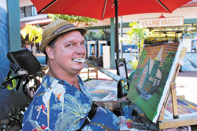 Talk about resilience! This is moses hamilton, a wonderful man here on the north shore you can often find painting in hanalei ... with his mouth. An accident many years ago left him a quadriplegic, but with resilience he's now a world renowned artist, painting amazing pictures of our island home.